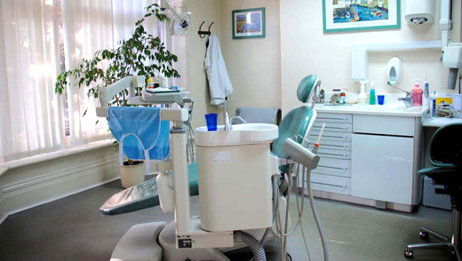 A photo of our surgery showing the dentist chair and high-tech equipment